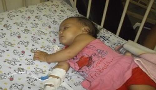 Maria Júlia, 6 meses, está há uma semana com tosse, febre, diarreia e cansaço (Foto: Álefe Souza)